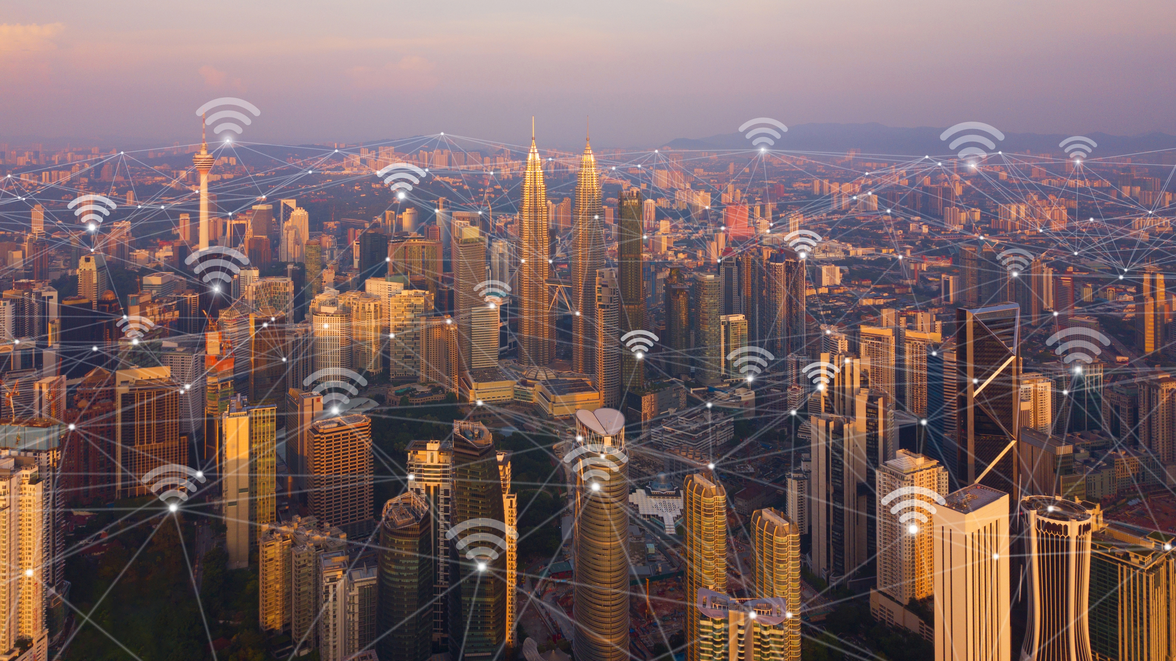 digital-network-connection-lines-and-wifi-icons-with-kuala-lumpur-downtown-malaysia-financial_t20_xRnXB9